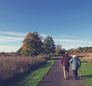 exercise for elderly walking together through park