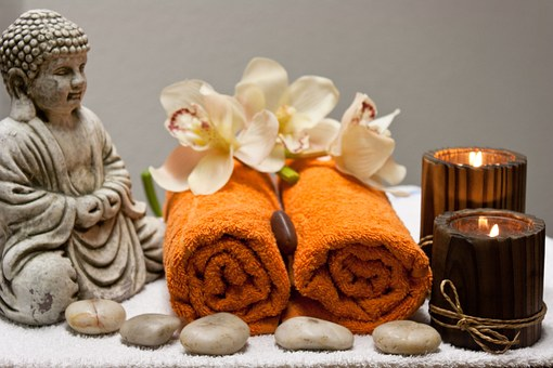 health club spa services with flowers and towels as well as spa equipment for treatments